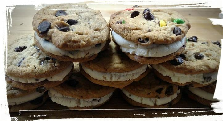 Cookie Sandwich with cream filling, topped with m&m pieces and chocolate chips