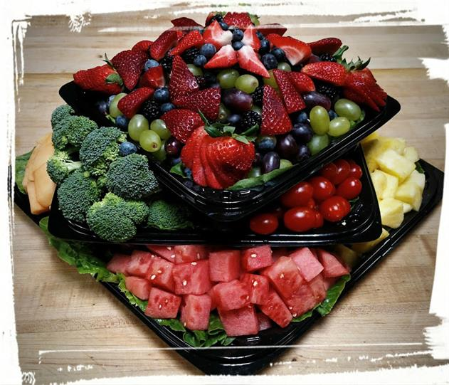 Assortments of Watermelon, Grapes, Pineapple, Strawberries, and broccoli