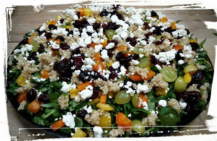 Salad with grapes, Feta cheese, carrots, lettuce, and quinoa