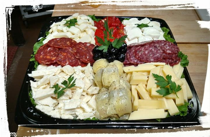 Assortment of Pepperoni, Salami, Olives, and Cheese on a platter