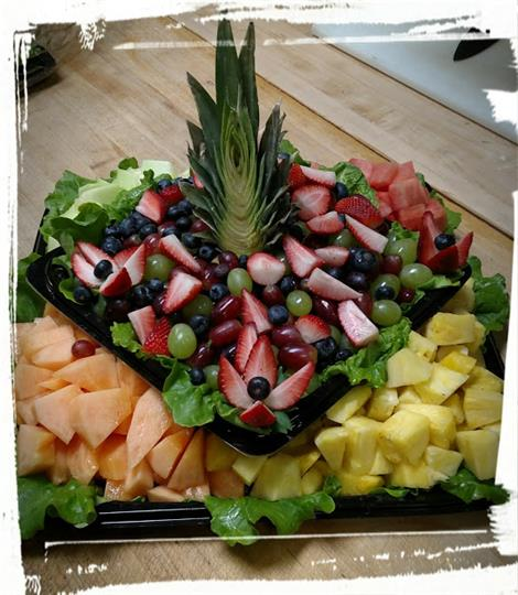Assortment of Cantalope, Pineapples, Grapes, and Strawberries