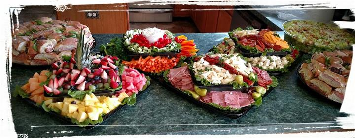 Assortment of multiple platters of Carrots, Cucumbers, Tomatoes, Fruits, Pepperoni, Ham,