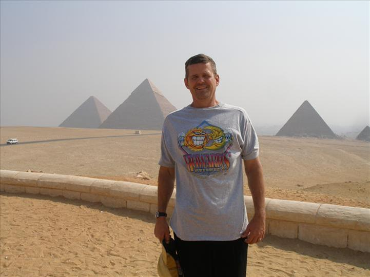 Kasey Warner visiting the Pyramids of Giza wearing Howard's Pub shirt