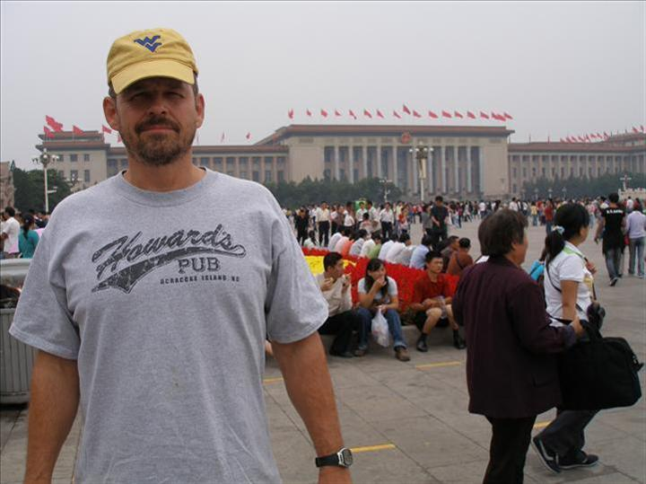 Kasey Warner inTianenman Square, China wearing Howard's Pub t-shirt.