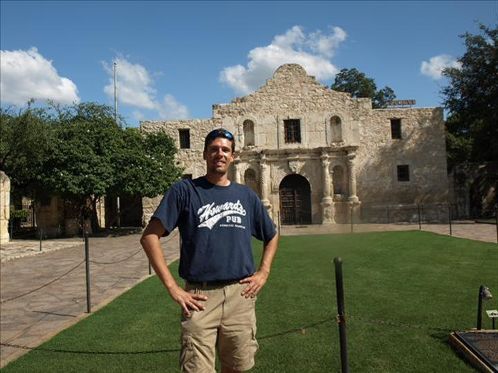Todd Lensing at the Alamo, San Antonio, Texas wearing Howard's Pub t-shirt