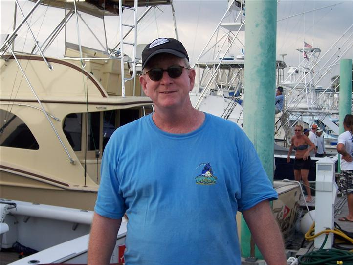 Jerry Coates Sail Fishing in Guatemala wearing Howard's Pub shirt