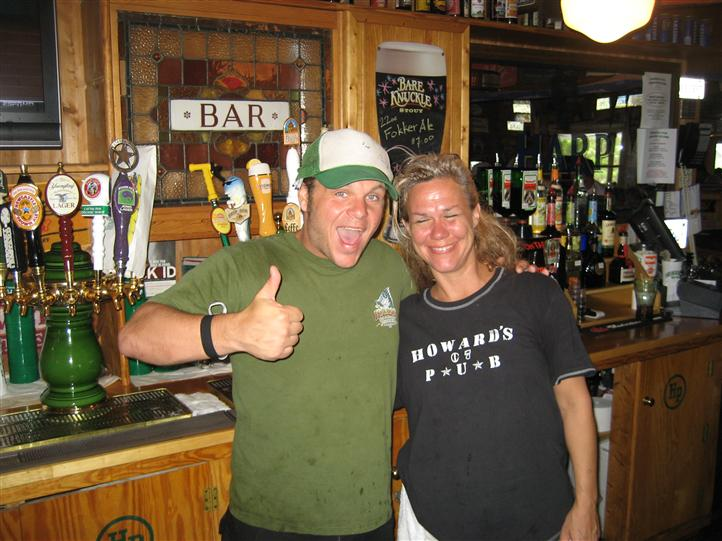 Howard's Pub patrons posing for photo at bar.