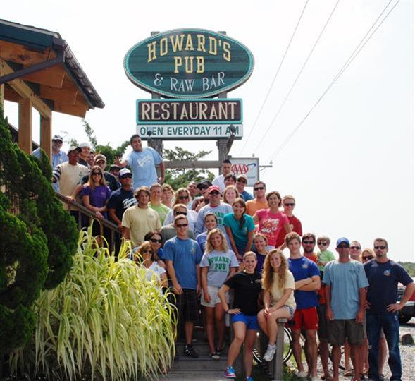 Howard's Staff in front of outdoor sign
