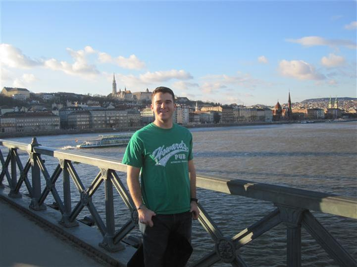 Man wearing Howard's Pub t-shirt looking over the Danube River in Budapest