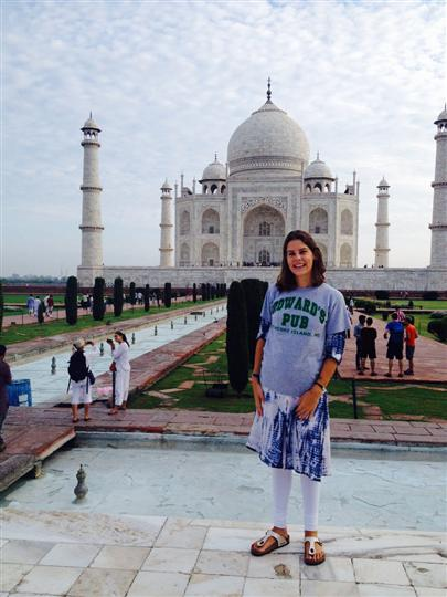 Woman wearing Howard's Pub t-shirt in front of Taj Mahal in India.