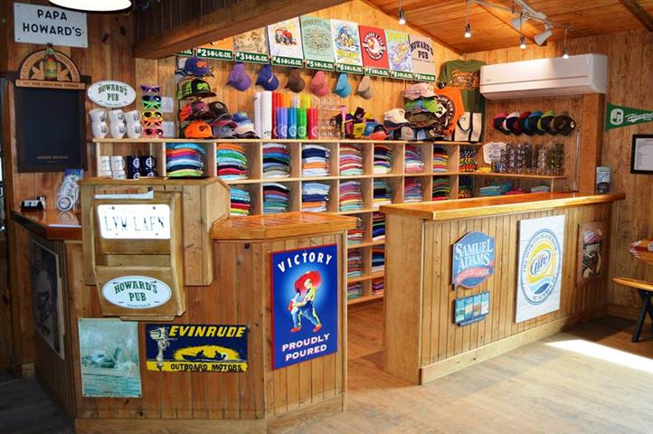 Howard's Pub gift shop with hats, t-shirts, cups.