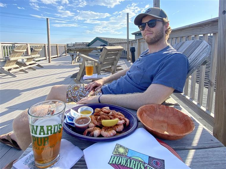 man with shrimp on the deck