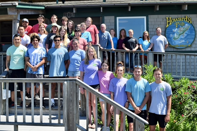 Howard's Staff 2021 standing outside on the stairs in front of the restaurant