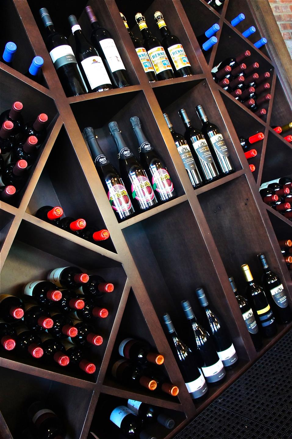 wine rack with several different types of bottled wine