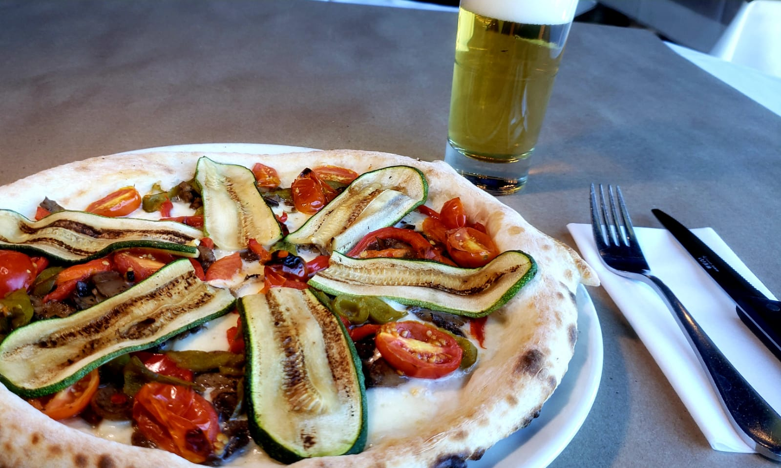 personal pizza with fresh zucchini and roasted tomatoes