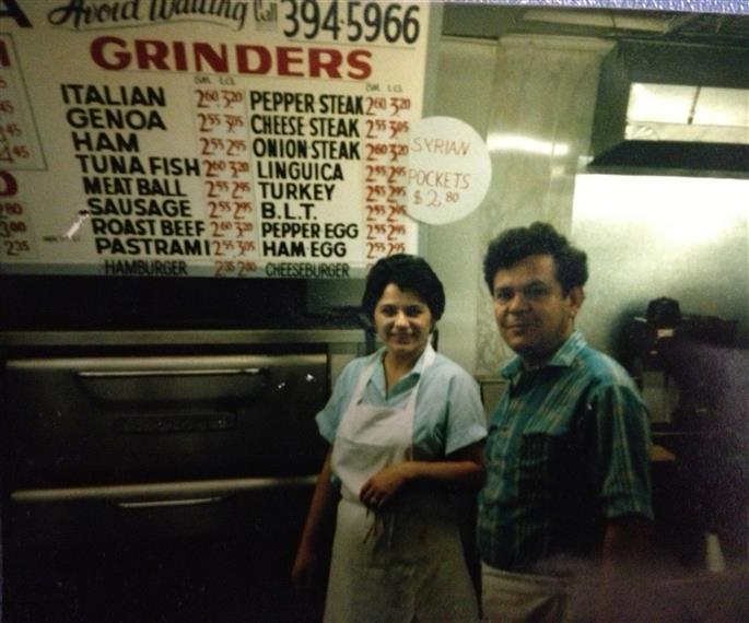 owners from 1985 standing in front of the pizza ovens