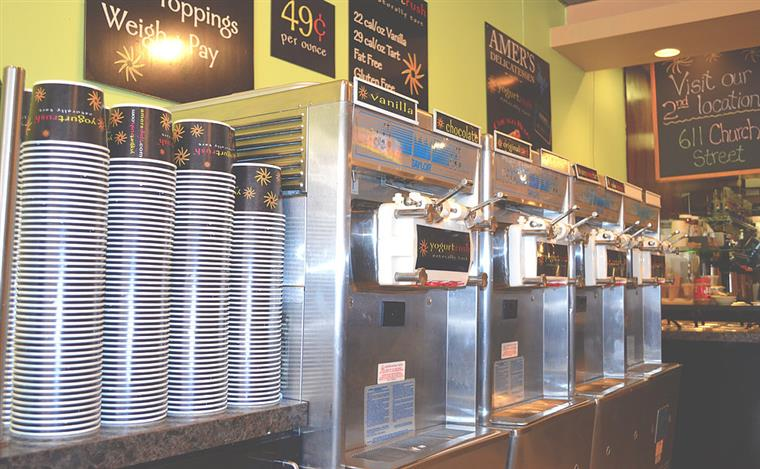Yogurt machines with cups.