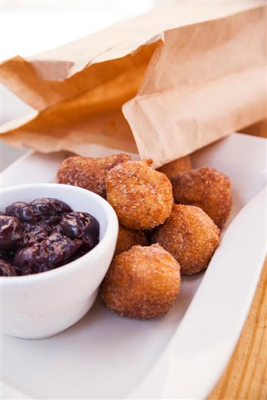 Cinnamon coated spheres with chocolate dipping sause