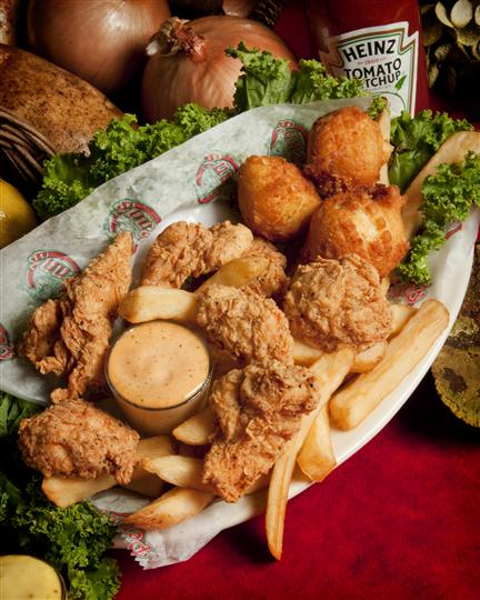 chicken tender dinner with hush puppies and french fries