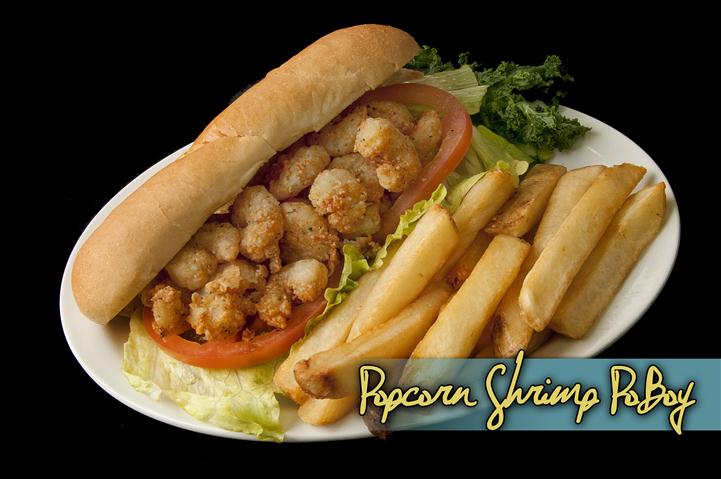 popcorn shrimp poboy with french fries