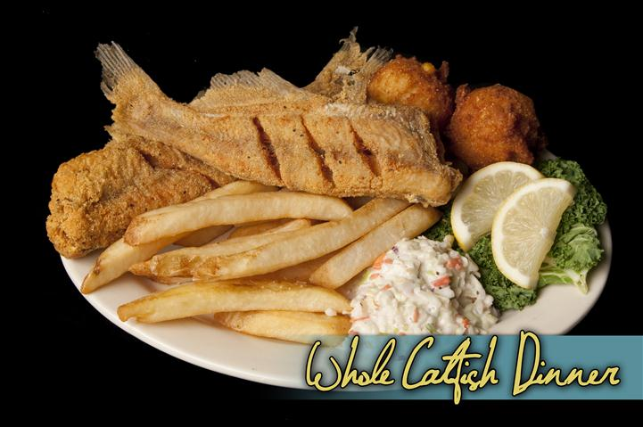 whole catfish dinner with french fries and hush puppies