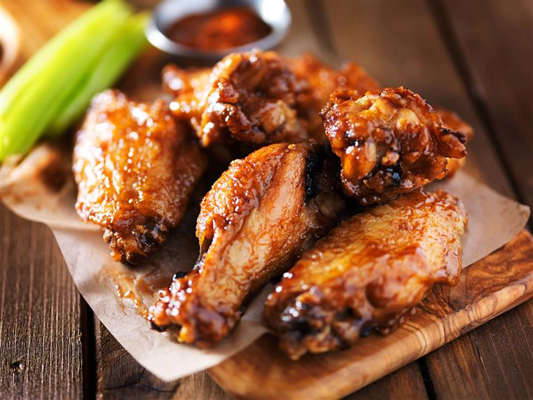 barbecue chicken wings with celery sticks