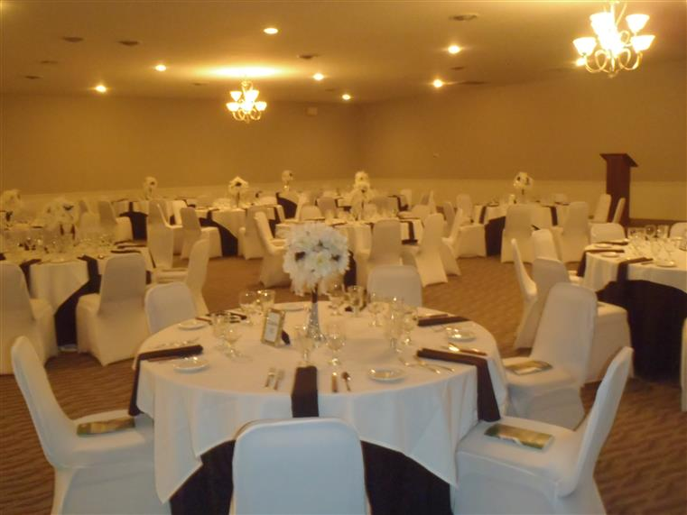 Banquet room showing tables and chairs covered in white