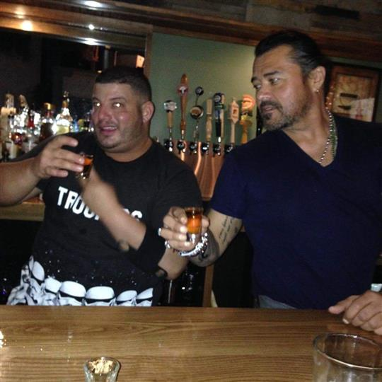 Two men drinking shots at the bar