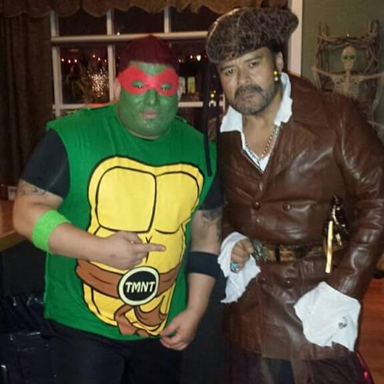 Two men dressed up posing for a photo in the bar