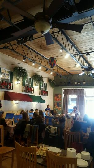 Interior shot of the Rock Garden Cafe with people