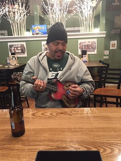 A man playing guitar in the Rock Garden Cafe