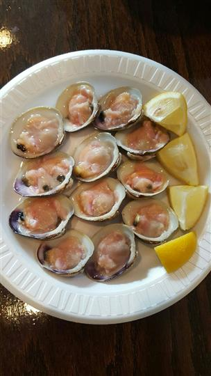 Raw clams on the half shell served with lemon