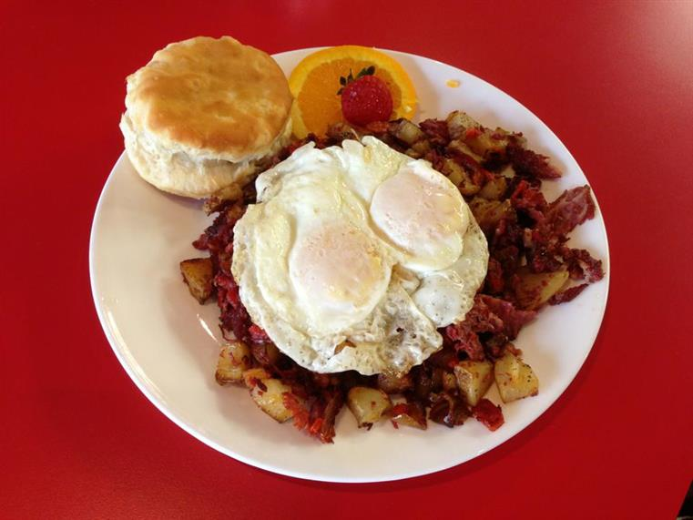bacon, potatoes, eggs, and a biscuit