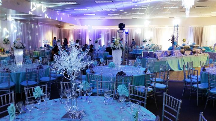 tables in the reception area with an ocean theme and crystaled centerpieces