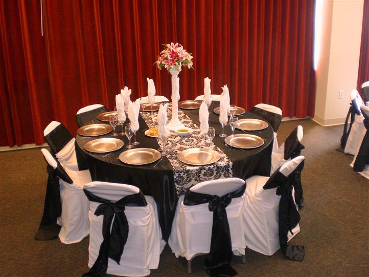 table setting with a lace runner and black/gold accents
