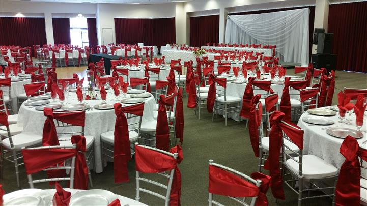 chairs with red bows on them