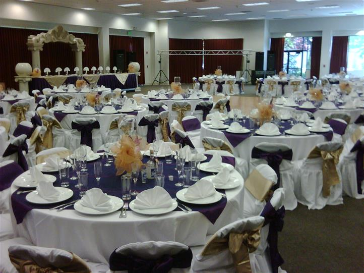 inside recption area with a purple tablecloth