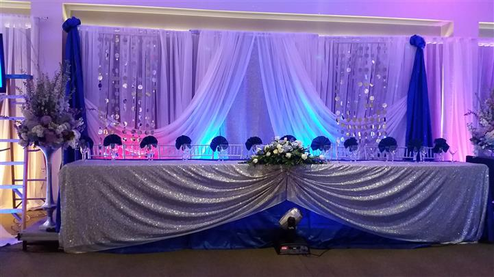 bridal party table with silver and blue accents