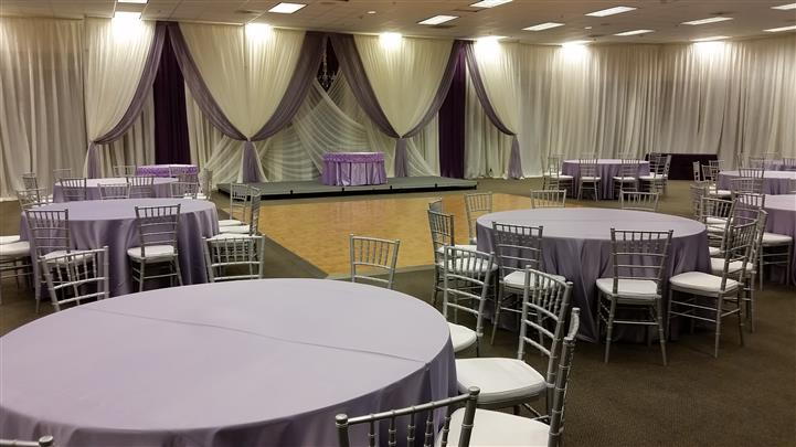 purple and white curtain display with the lights on