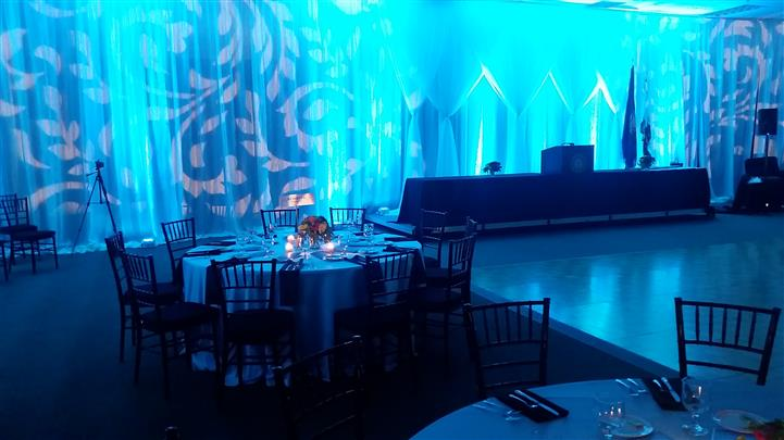 tables set up with a teal light background