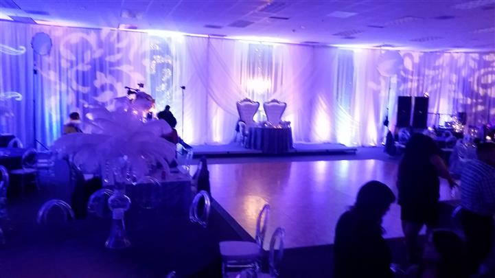 reception with the lights dimmed and white lit up curtains