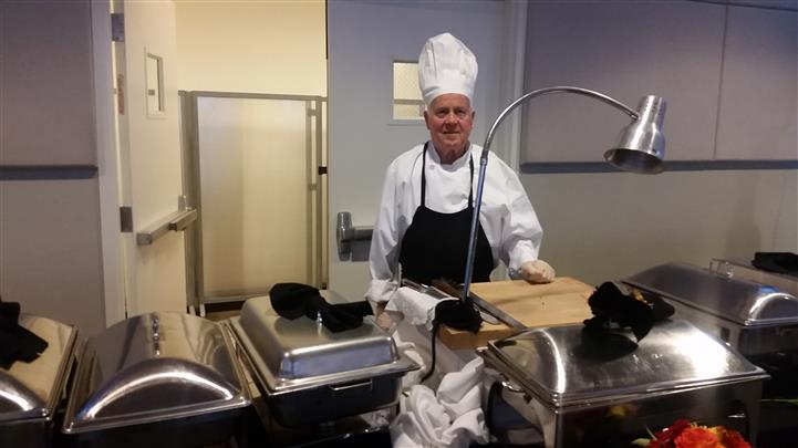 chef behind the catering table