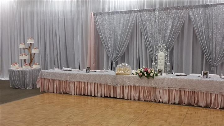 table setup with silver and pink accents