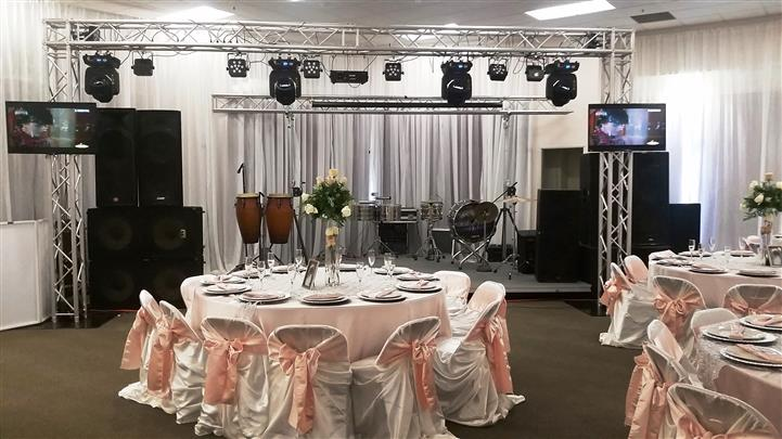 band setup with pink ribbons on the chair