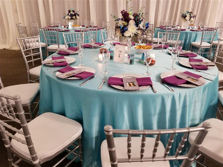 teal blue tableclothes with purple napkins