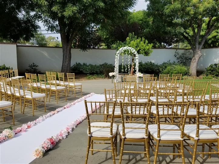 outdoor ceremony setting with a flower aisle