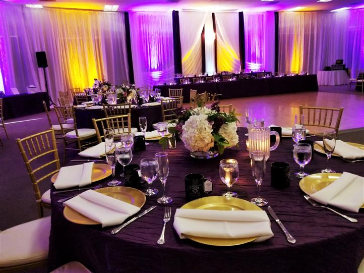 table setting with gold and black accents