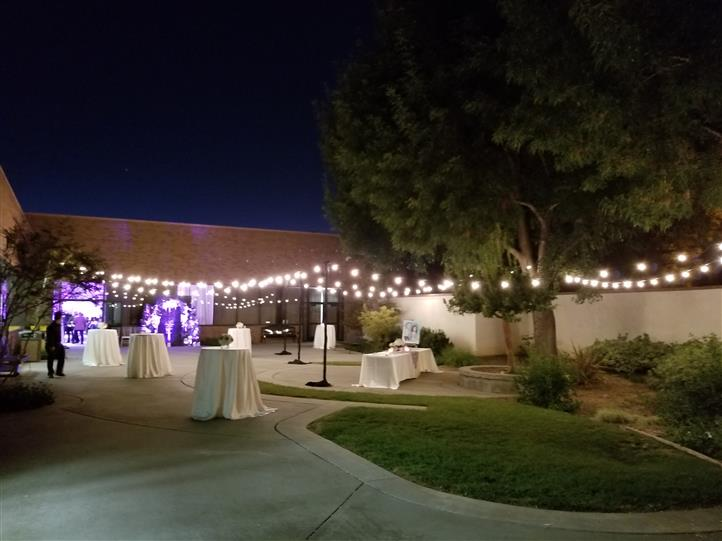 outdoor reception area with bistro lights