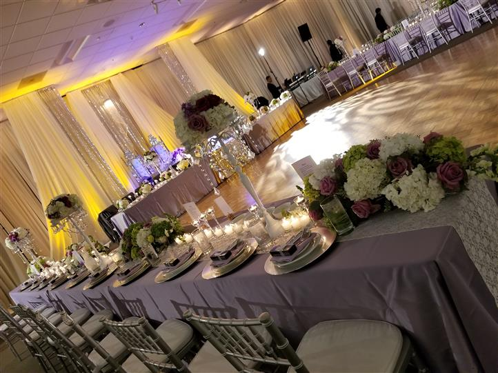 bridal party tables with purple accents
