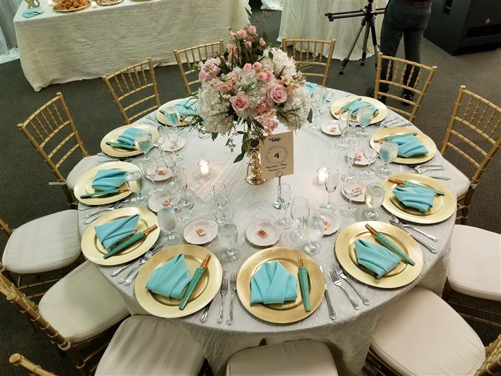 wedding table setting with teal accents